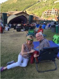 Cathy DeWitt Dunn and Sam at an outdoor theater